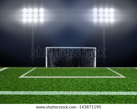 Empty soccer field with spotlights - stock photo