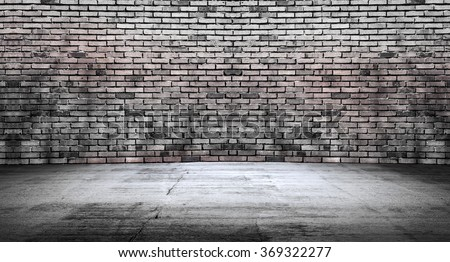 Empty space, concrete floor with desaturated bricks
