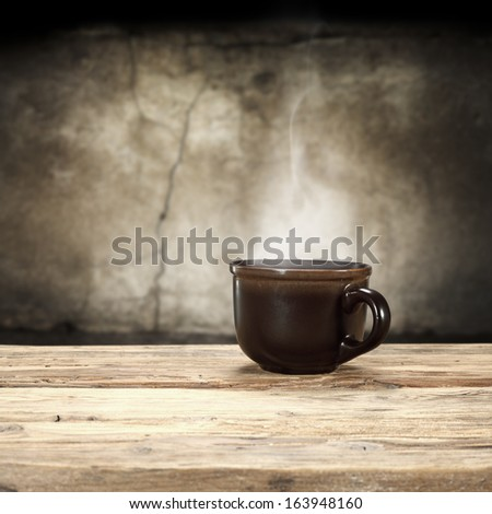 empty space on desk and mug with smoke  - stock photo