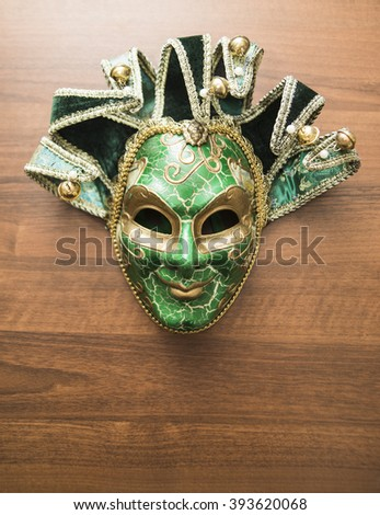 empty space wooden background and green carnival carnival mask  - stock photo