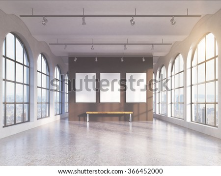 Empty spacious hall with huge roman windows on two sides with city view, three white boards on the grey back wall, a wooden bench under them. Front view. Concept of exhibition - stock photo