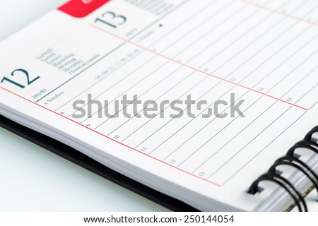 empty spiral weekly agenda - stock photo