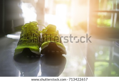 Empty sport shoe on the floor with sun light effect