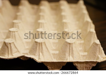 Empty spots of a egg box - stock photo