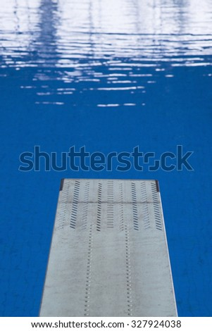 empty spring board in an empty swimming pool - stock photo