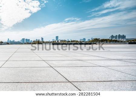 Empty square and floor with sky