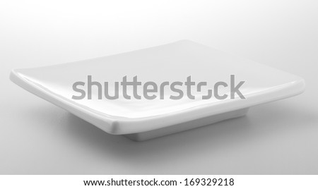 Empty square ceramic plate low angle shot on white background - stock photo