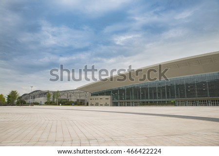 Empty square in front of building with blue sky