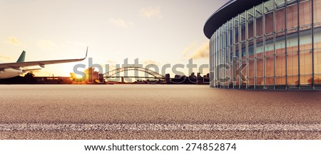 Empty square with airplane,modern building and sydney landmark as background - stock photo
