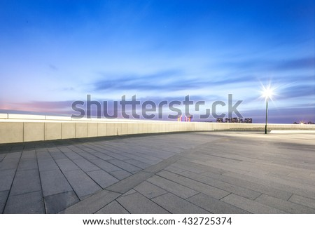 empty square with cityscape and skyline at sunrise in harbin - stock photo