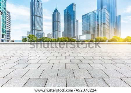 empty square with modern buildings background - stock photo