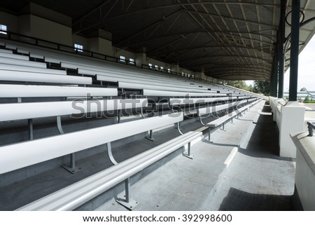 Empty stadium metallic bleachers from side view in day time