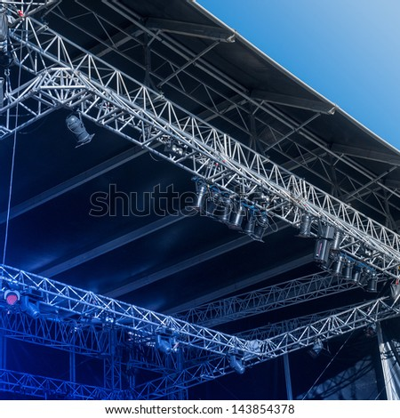 Empty stage before a concert with blue light switched to ON - stock photo