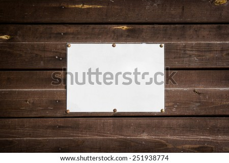 empty standard sheet on a wooden wall - stock photo