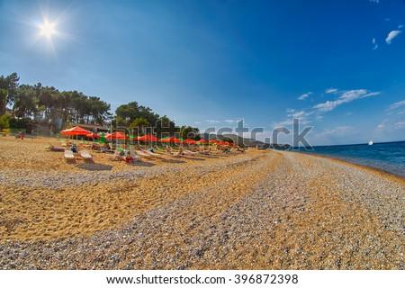Empty Stone Skala Beach of Kefalonia, Greece at Sunset - stock photo
