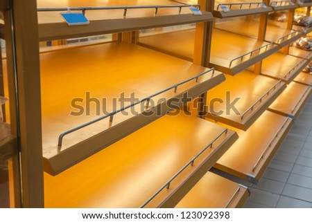 empty store shelf in the super market - stock photo