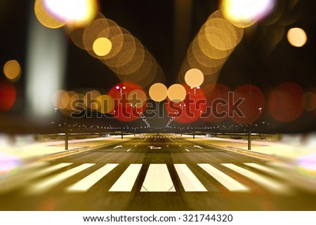 Empty street city at night and lamp post light flares.Road background.Abstract cityscape  - stock photo