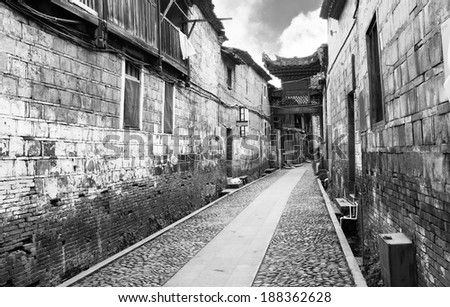 Empty street of an ancient chinese town with traditional chinese architecture - stock photo