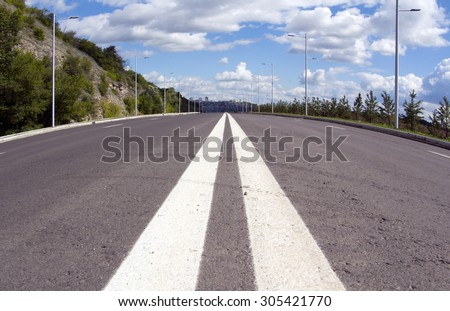 Empty street to big city. Blue sky and white cloud. Wide angle - stock photo