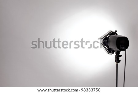 empty studio background and flash light on light grey - stock photo