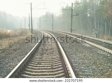Empty suburban railroad leading to the horizon on a sunny clear day