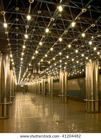 empty subway station with shiny steel colonnade - stock photo