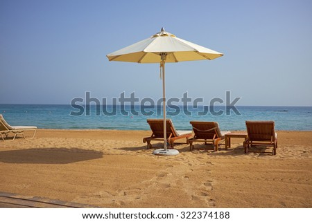 empty sun loungers on the beach