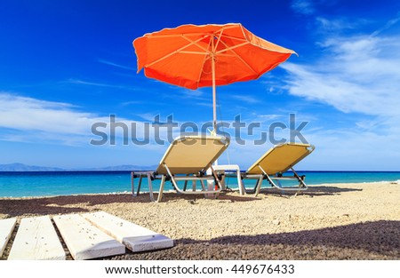 Empty sun loungers on the beach before summer