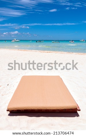 empty sunbed on tropical beach in Isla Mujeres, Mexico - stock photo