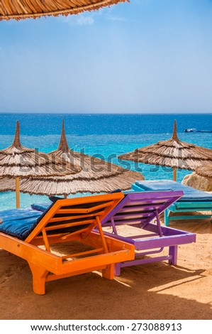 Empty sunbeds on the beautiful tranquil beach in Sinai, Sharm el sheikh