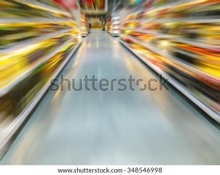 Empty supermarket aisle, motion blur - stock photo