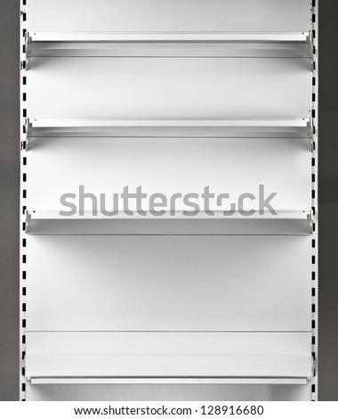Empty supermarket shelf. Retail store equipment - stock photo