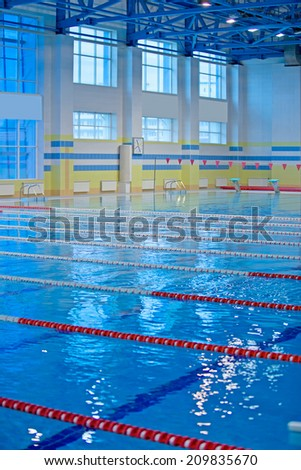 Empty swimming pool for competition. - stock photo