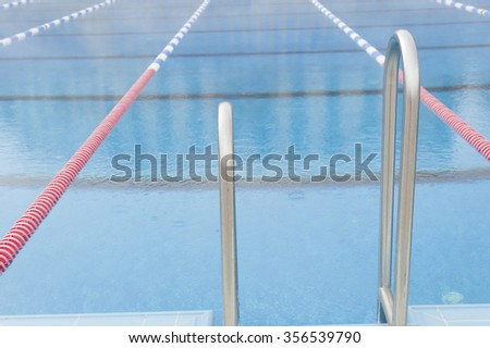 empty swimming pool holder ladder - stock photo