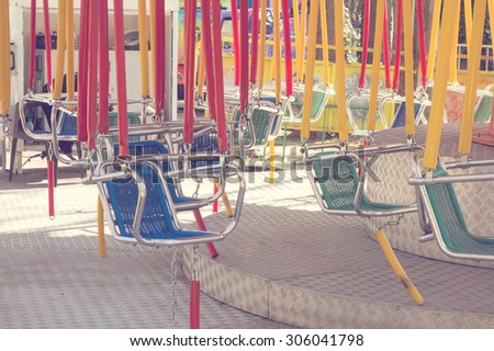 Empty swing on children playground - stock photo
