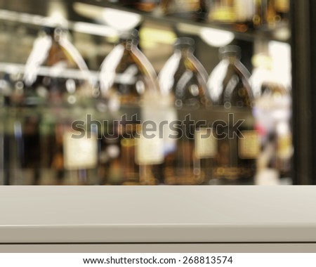 Empty table and blurred vintage bottle with bokeh background, product display showcase - stock photo