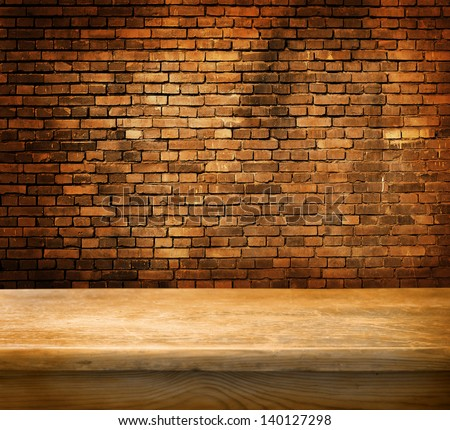 Empty table and brick wall in background. Great for product display. - stock photo