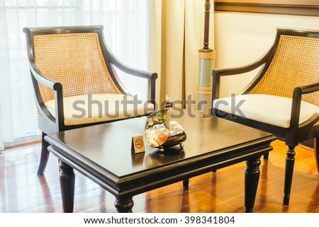 Empty table and chair decoration in living room interior - Vintage Light Filter - stock photo