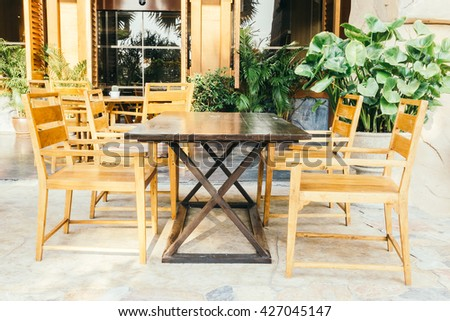 Empty table and chair decoration in restaurant interior - Vintage Light Filter