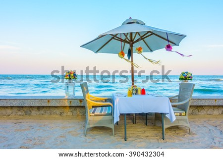 Empty table and chair for romantic dinner on the beach - Vintage Filter