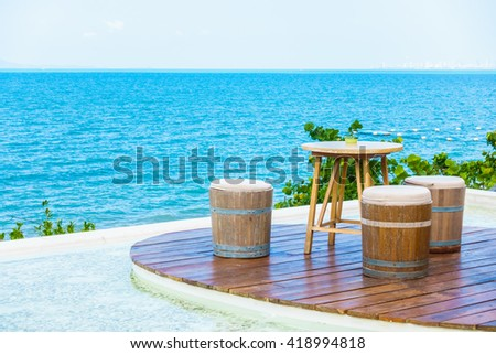 Empty Table and chair on the beach and sea background - stock photo