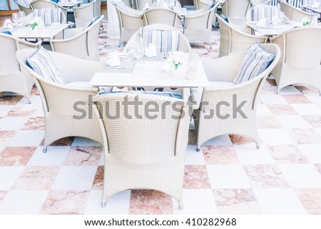 Empty table and chair setting for dinning in restaurant - Vintage Light Filter