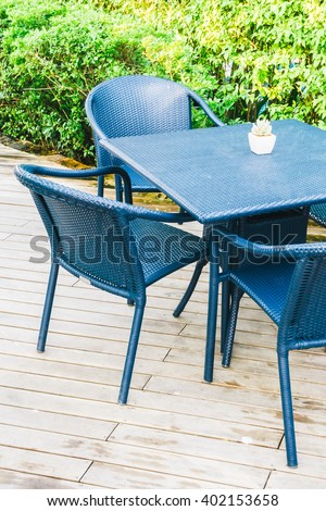 Empty table and chair with outdoor view - Vintage light Filter