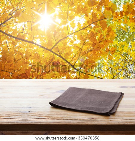Empty table and tablecloth, Autumn background, for product display montage. Mock up for design