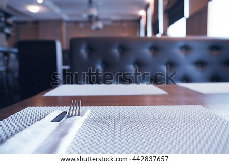empty table background blur interior of the restaurant