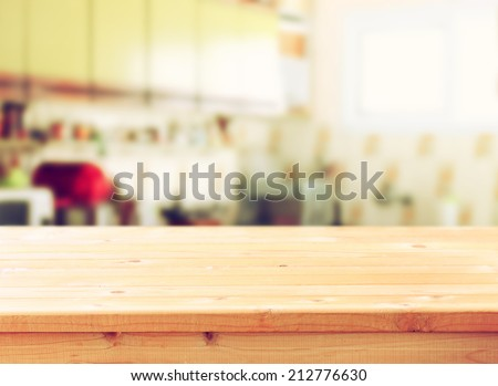 empty table board and defocused retro kitchen background, - stock photo