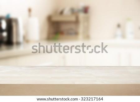 empty table board and defocused white retro kitchen background  - stock photo