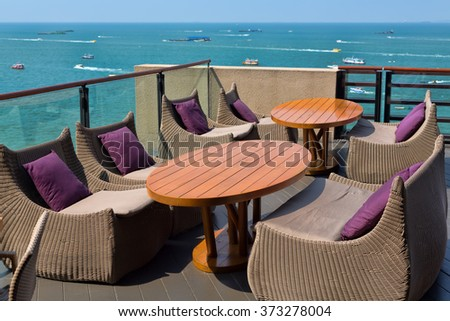 Empty table in a restaurant overlooking the sea. - stock photo