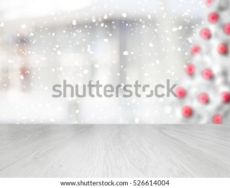 Empty table in front of a blurred Christmas tree