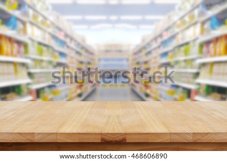 Empty table on blured supermarket background